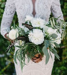white bouquet with eucalyptus, genre. olive and feathers