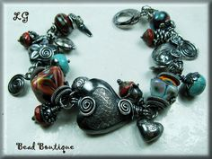 """""""Bohemian Dancer"""" - Lisa Grant free form hand wire wrapped, Antiqued Sterling Silver bracelet with Artisan Lampwork by Janette Nethercott - SOLD"""