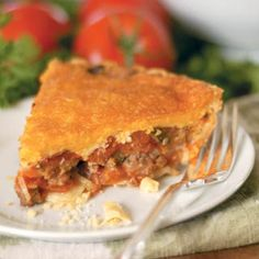 Tomato Pie (this delicious deep dish pie contains fresh tomatoes, Italian Sausage, onions and seasoning topped with Swiss and cheddar cheese!) | Farm Flavor