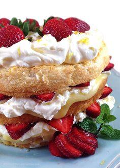 Lemon Cream Strawberry Angel Food Cake: angel food cake layered with lemon curd, lemon cream, and fresh strawberries for a light and airy dessert.