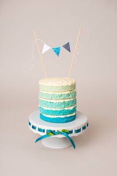 Naked teal ombré smash cake  by cake, love, crossbones by holland  Photo by Footsteps photography