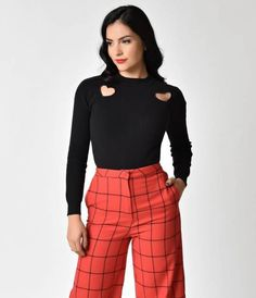 af980625e8 This midnight black sweater top boasts two plump heart cutouts on each  shoulder