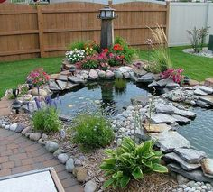 Beautiful garden pond also separates the backyard space.