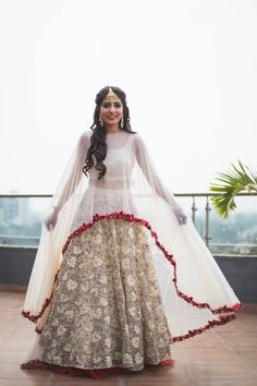 Light Lehengas - White and Gold Applique Work Lehenga with a White Cape and Red…