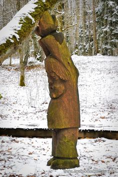 A wonderful wood carving of a man holding up a tree, found in a Lithuanian forest.