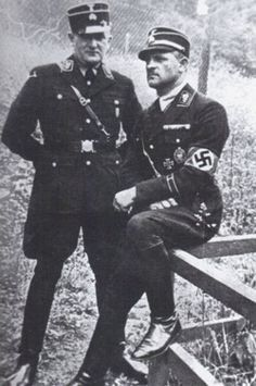 "Hitler's Gladiator SS-Standartenführer Josef ""Sepp"" Dietrich sits next to SS-Oberführer Fritz Weitzel in an early photo wearing the early style SS-Kepi style hat"
