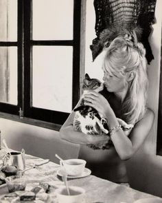 Animal lover Brigitte Bardot (young, in a bikini (I assume; we can't see it)) with a little kitty,1960s.