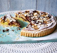 A pear and almond tart with swirls of melted chocolate marbled through it for extra decadence