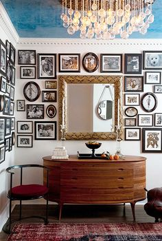 Painted ceiling, curved teak dresser, large mirror and a myriad of pictures (maybe too many)