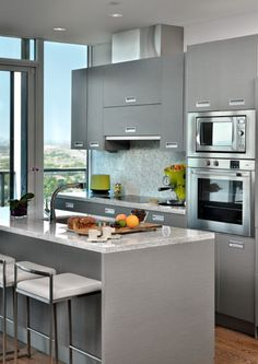 modern kitchen with gray cabinets, pantone sharkskin, gunmetal gray, battleship…