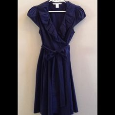 DVF Bethania Tech Poplin Wrap Around Navy Dress This is a beautiful dress from Diane von Furstenberg in the Bethania style and navy blue color. The dress has a bubble ruffle collar and cap sleeves. The length is 38 inches from back of neck to bottom hem. Shoulder seam to shoulder seam across the back is 14.5 inches. Material is 88% polyamide / 12% elastane. This dress is in excellent used condition. Diane von Furstenberg Dresses Midi