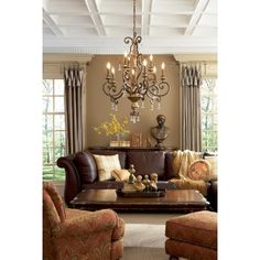 Quoizel Marquette 9 Light 32 inch Heirloom Chandelier Ceiling Light - - Beautiful living room with attention to details. The furnishing at accessories are simple and classic and details like the ceiling and drapes give the room ultimate style. Home Living Room, Living Spaces, Living Area, Living Room Decor Brown Couch, Living Room Ideas With Leather Sofa, Living Room Warm Colors, Living Room Drapes, Cozy Living, Small Living