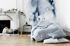Transform your home space with design risk. Try unique decor trends like watercolor walls, half-painted walls, unfinished wallpaper, wallpapered stairs and diagonal door paint.