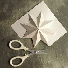 Looking to #craft something #special for the #Christmas season but don't have that much time? #Paper #Christmas #Ornaments, Christmas #Decorations, Christmas Decorating #Ideas, How to make a #Star #Chandelier with #paper #stars...