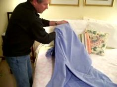 How to fold a fitted sheet like a pro. This guy is better than Martha Stewart!