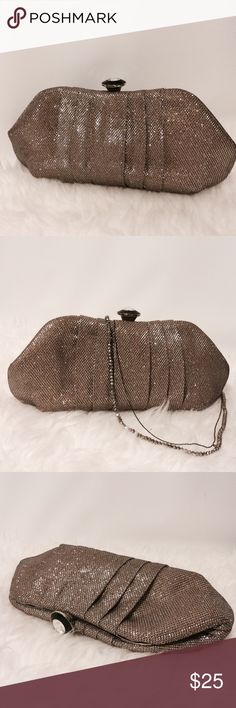 "Shimmering Taupe Pleated Evening Clutch Add elegance to that special occasion! Pleated front, jewelry closure, chain link chain, fully lined with one interior pocket. 10"" W X 5"" H Bags Clutches & Wristlets"