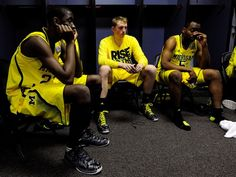 Michigan Wolverines guard Caris LeVert sits in the locker room with teammates after losing to the Louisville Cardinals in the championship game at the Georgia Dome.