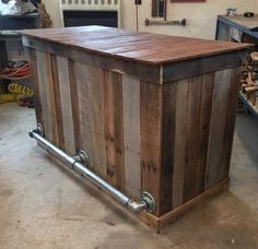 Pallet bar with a pipe foot rail is a nice finishing touch