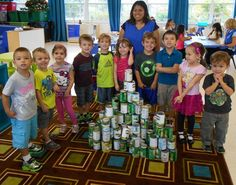 Class at Preschool at the Lamb making pyramids from cans. #kids #classroom