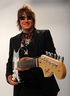 """Why didn't you use the guitar to play in the whole """"Because We Can Tour""""?You preferred touring with Orianthi and other artists (with all the respect for them,especially for Stevie Wonder and Aerosmith!),but not with your band/for us?It's unbelievable!I'm still so pissed off!"""