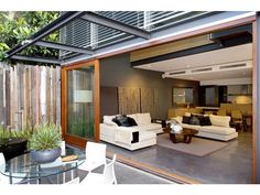 #polished concrete floor, bi-fold doors, recycled timber fence - fabulous.