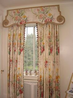 What an interesting cornice! The oriental design is enhanced by the trim. Then a different trim- tassels-is used on the draperies.Really creative!