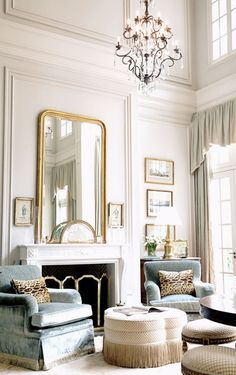 Beautiful living room with chandelier from This is Glamourus
