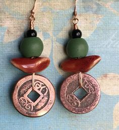 A lovely combination of beads accentuate these pieces made of vintage Asian coins. A sweet pair of dangle earrings comfortable to wear that have a boho / hippie vibe.