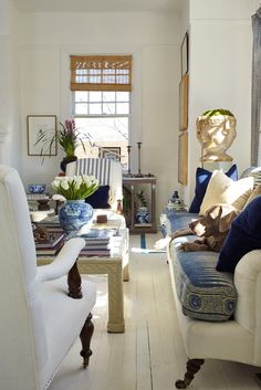 white floors and high walls provide 'breathing space' for the massed furnishings/objects.