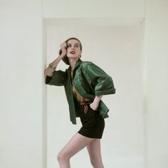 50s, oversized, green, patch-pocket shirt with a gold blouse and black shorts tied at the waist with a gingham sash, all by Brigance of Sportsmaker