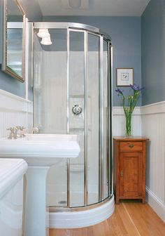 Not sure about the rounded shower...but it might be a space saver....traditional bathroom by Charlie Allen Restorations Inc