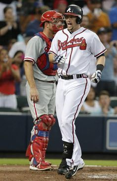 Atlanta Braves; Chris Johnson crosses the home plate after hitting a two-run home run in the third inning against the Philadelphia Phililies in a baseball game.
