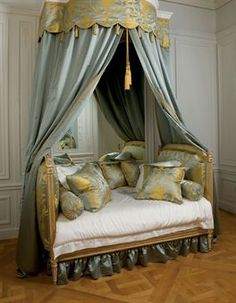 A LOUIS XVI GREY AND WHITE-PAINTED AND PARCEL-GILT BED (LIT EN ALCOVE), circa 1775 by Jean Avisse