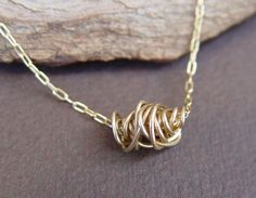 gold wrapped wire necklace.