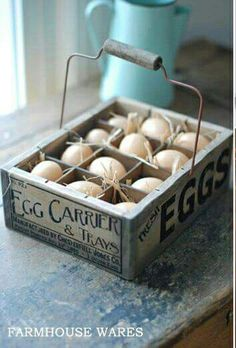 the wooden egg crate features a vintage style company logo, wire handle, and one dozen plastic eggs nestled in straw Primitive Bathrooms, Primitive Kitchen, Primitive Decor, Country Primitive, Vintage Farmhouse, Farmhouse Decor, Farmhouse Style, Egg Crates, Wooden Crates