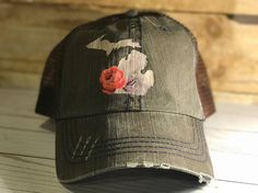 Brown denim distressed trucker hat with Michigan silhouette