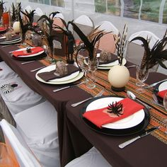This is an African themed summer family party in the garden. I have used ostrich eggs, porcupine quills and model elephants, as well as raiding the local shops for models of bugs and African animals.