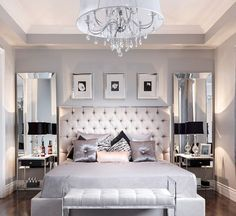Affordable way to make bedroom look elegant is with a fresh coat a paint and a nice chandelier.