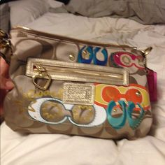 Never Used, Gold Coach Purse NWOT- Gold coach purse with colorful design on one side. Never been used. Comes with short and long interchangeable handle/strap. I have matching wallet as well. Coach Bags