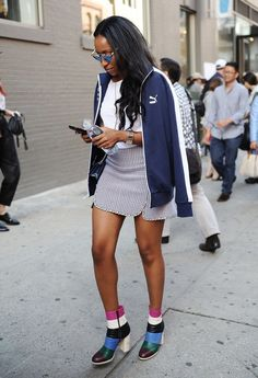 Pin for Later: 14 Street Style Fashion Hacks to Try Right Now Toss a Sport Jacket Over a High-Fashion Ensemble Give your outfit a more relaxed feel by tossing a track jacket over your shoulders before you head out the door.