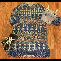 GORGEOUS NEW GRACE K TUNIC! SZ L NEW SIZE LARGE, GRACE K TUNIC! BLUE & CREAM COLOR WITH ORANGE, GREEN & BLACK ACCENTS! BELT TO WEAR WITH SHORTS AND FLIP FLOPS, OR PAIR WITH FLATS OR WEDGES AND LEGGINGS OR SKINNY JEANS!  100% POLYESTER Grace K Tops Tunics