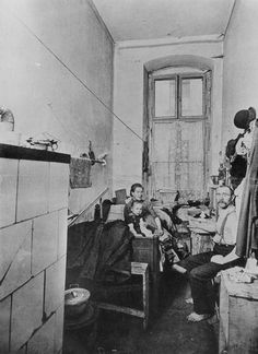 Working Class Quarters 1910-individuals and entire families left the countryside and moved to cities in search of work. Living conditions were often miserable: working-class housing was dank, cramped, and overcrowded, with little fresh air or natural light. Entire families lived in narrow rooms without indoor plumbing. One such quarter on Berlin's Liegnitzer Straße is depicted here. The rent for this type of space would have consumed a large portion of a family's income.