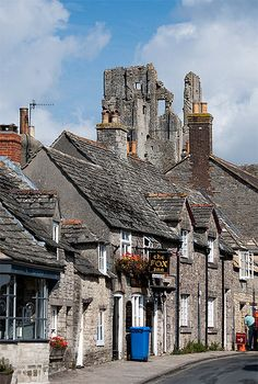 ~Corfe Castle is a fortification standing above the village of the same name on the Isle of Purbeck in the English county of Dorset. Built by William the Conqueror, the castle dates back to the 11th century and commands a gap in the Purbeck Hills on the route between Wareham and Swanage…~