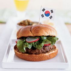 Korean Barbecue Burgers | MyRecipes.com - These burgers are based on bulgogi, a traditional Korean barbecue specialty of marinated sirloin. If you prefer more authentic flavor, just top with a splash of rice vinegar and kimchi, the spicy-hot pickled vegetable condiment available at Asian markets. Serve with rice crackers.