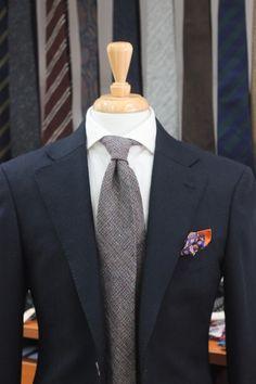 blue blazer. white oxford. multi-colored tweed tie. orange bordered paisley pocket square. simple. modern. clean. style.