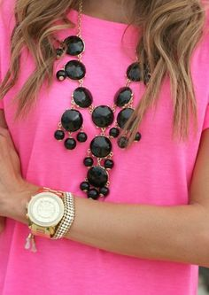 Neon pink shirt with a black statement necklace. An easy outfit that is pretty and fun