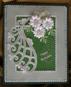 Cute paisley pattern birthday card with 3-D punched daisies.