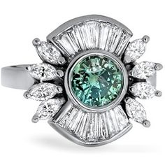 The Dorothea Ring - This exquisite, breathtaking ring in white gold features a fancy intense green diamond at its center. Marquise and tapered baguette accents radiate from the center bezel for a fanciful and unique piece.