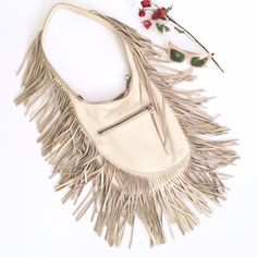 Linea Pelle Leather Fringe Shoulder Bag Absolutely stunning Linea Pelle Collection handbag. Super comfortable and rests on shoulder with a single strap. Zipper top closure. Cream/bone color. Long fringe all over. Exposed natural suede interior. Great condition with very minimal wear- see the last photo where there is one mark on the interior of the strap. Because it's in the inside though you can't see it when worn. :) Super eye catching piece! Mates anthro for exposure. Anthropologie Bags…