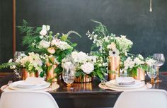 clear flower vases covered with copper metal sheets - wonderful idea. it's gorgeous!
